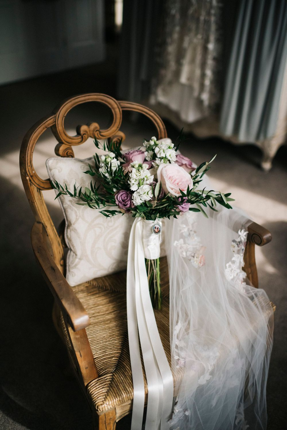 brides bouquet, summer wedding at eaves hall, eaves hall wedding, summer flowers, brides bouquet on chair