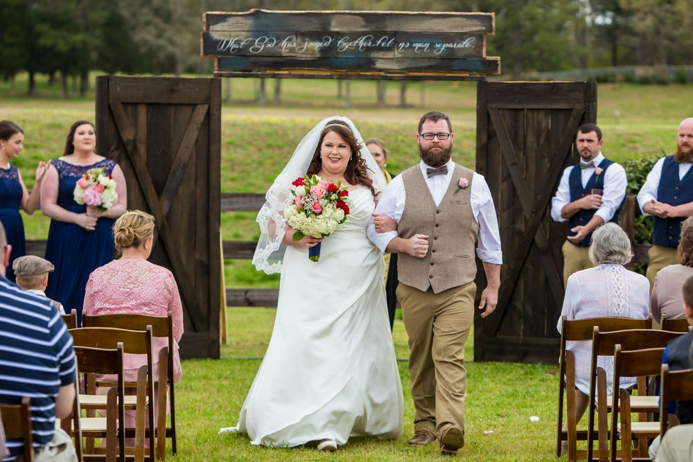 Bride and groom walk down the aisle during a wedding ceremony at the Farm at Ridgeway in Ridgeway, SC