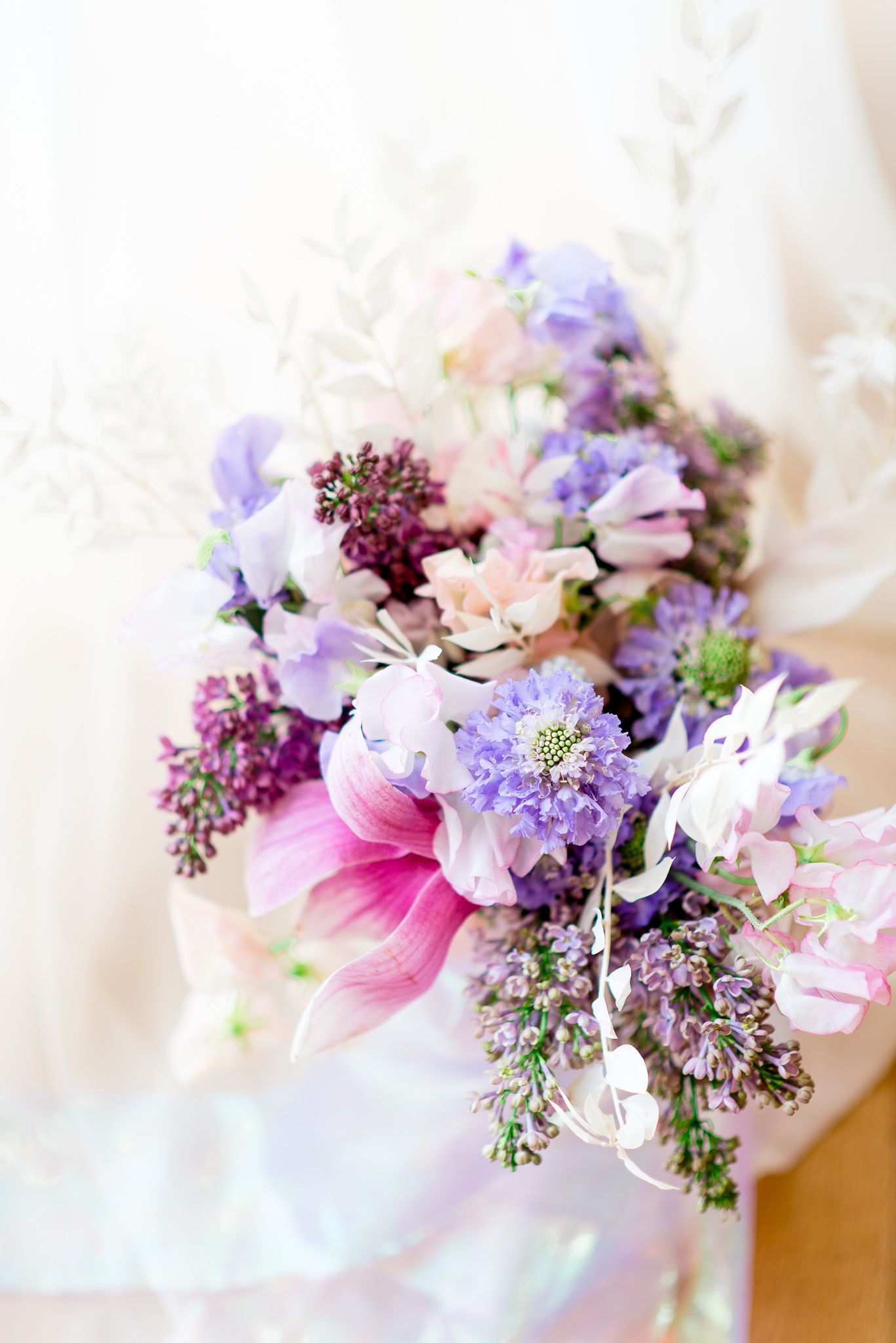 pink and purple bouquet with lilacs by Carly Messmer Floral for a wedding at The Center Cincinnati