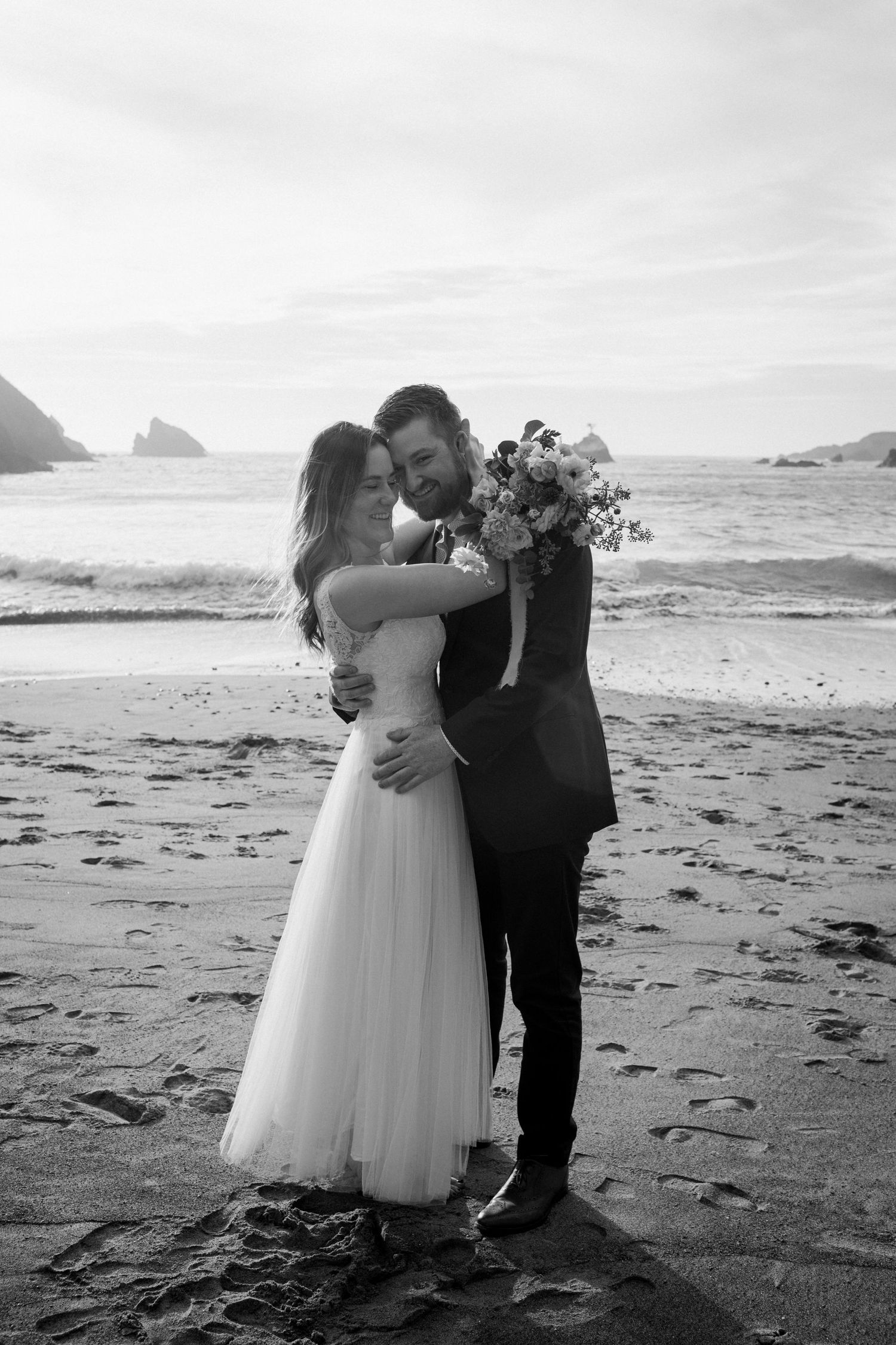 Black and white wedding elopemen photo from Mendocino, California.
