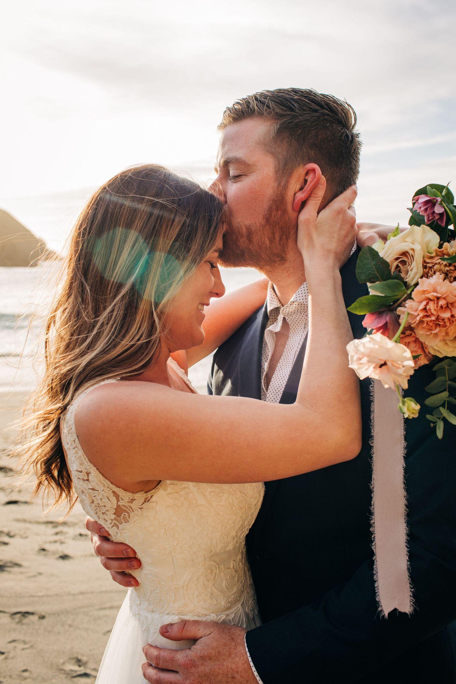 The sun shines on this newly wed couple from in Mendocino, California.