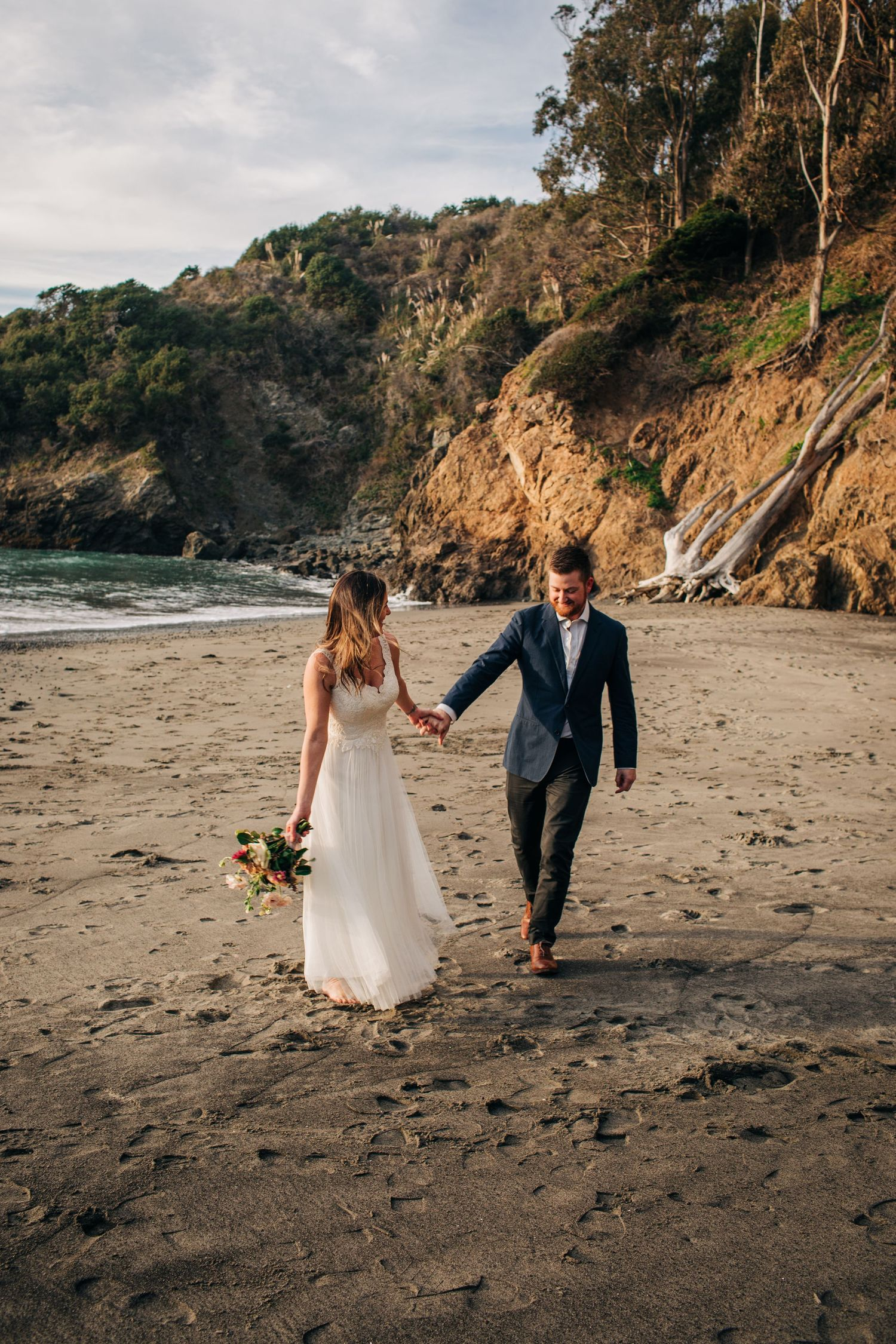A newly married couple walks together on their elopement wedding day in Northern California.