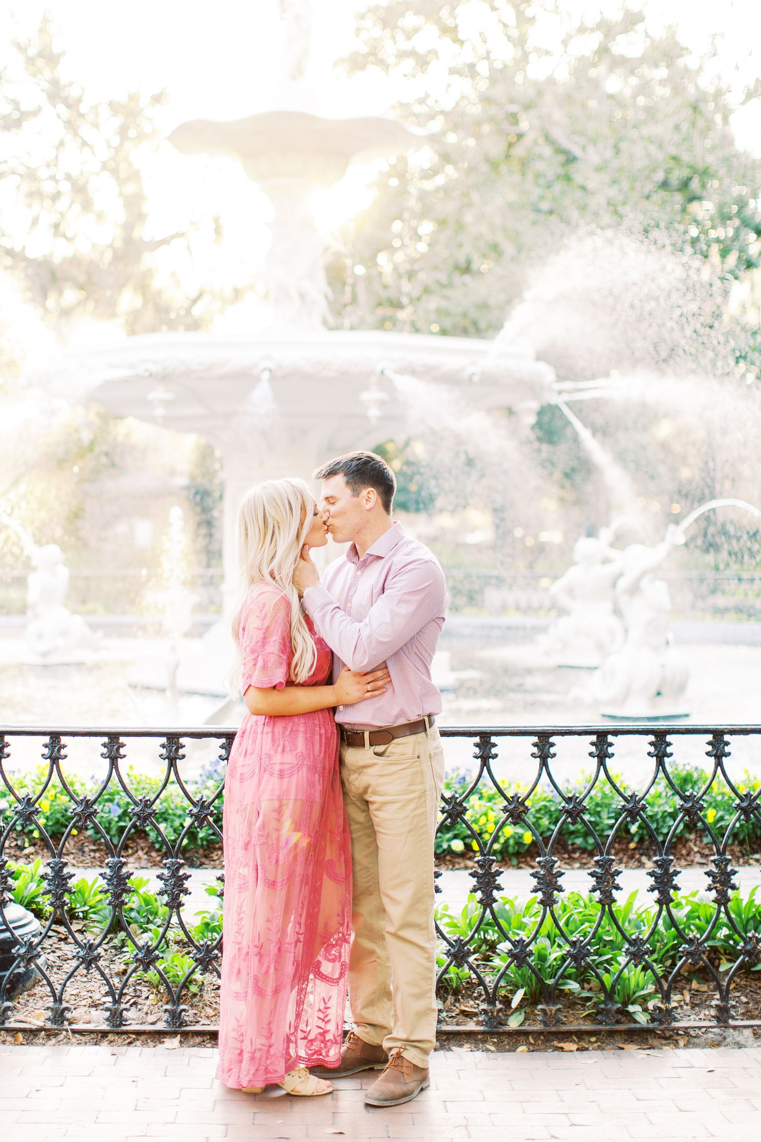 couple kisses in front of the fountain in forsyth park in downtown savannah, ga