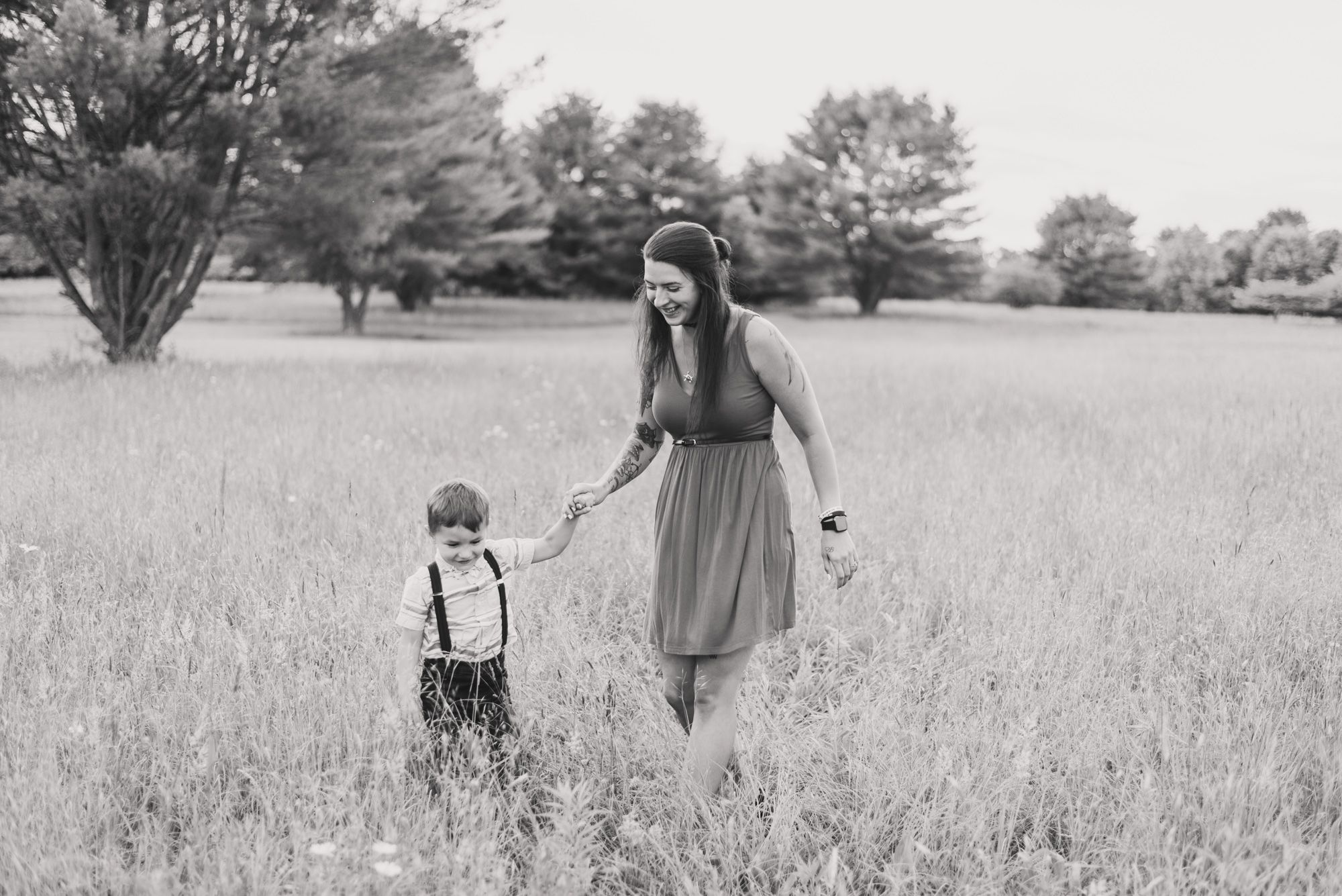 Mother and son running through field in black and white in Clarion Pennsylvania