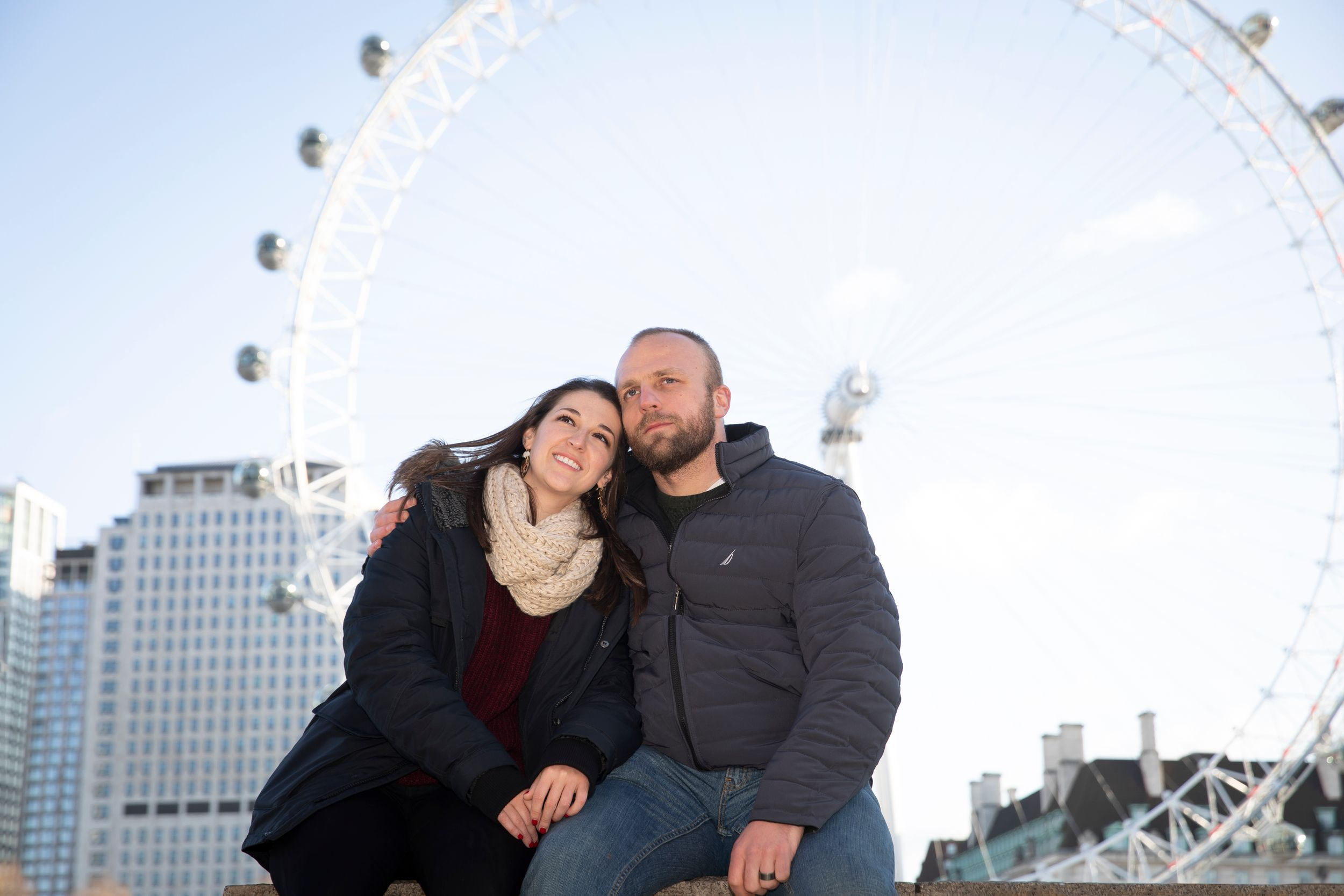 Couple portrait in front of London Eye