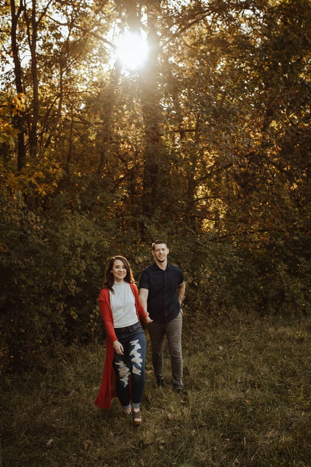 Blog Engagement Session Kansas City Photography Couple Strolling through woods with sunset