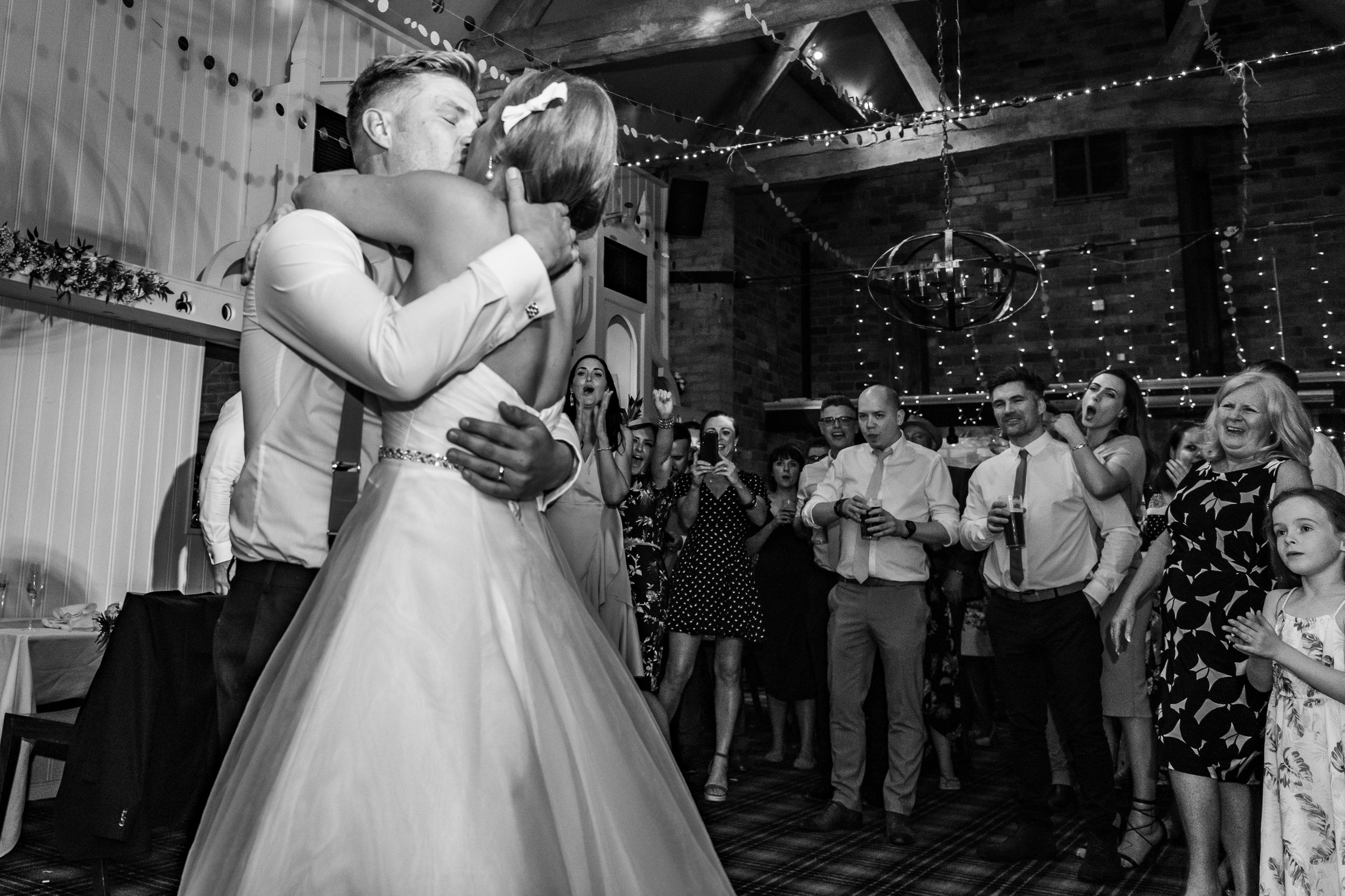 bride and groom kissing on the dance floor