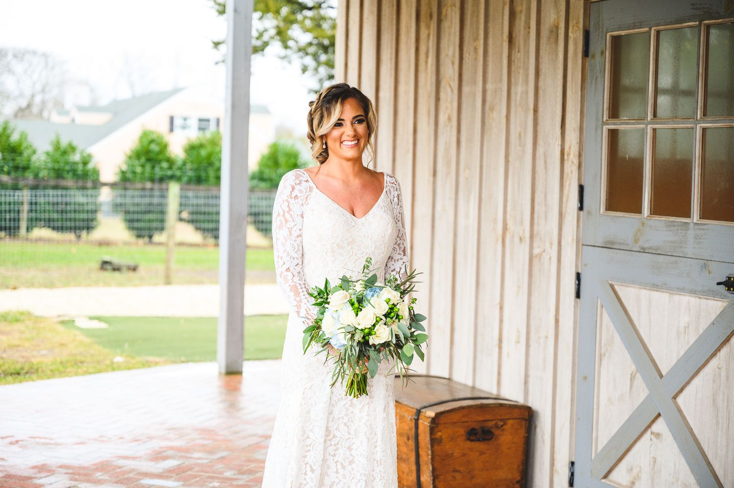 bride smiling in white wedding dress during first look