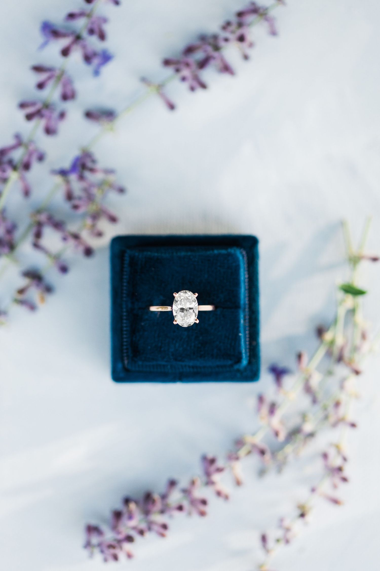 Timeless oval engagement ring in navy blue box