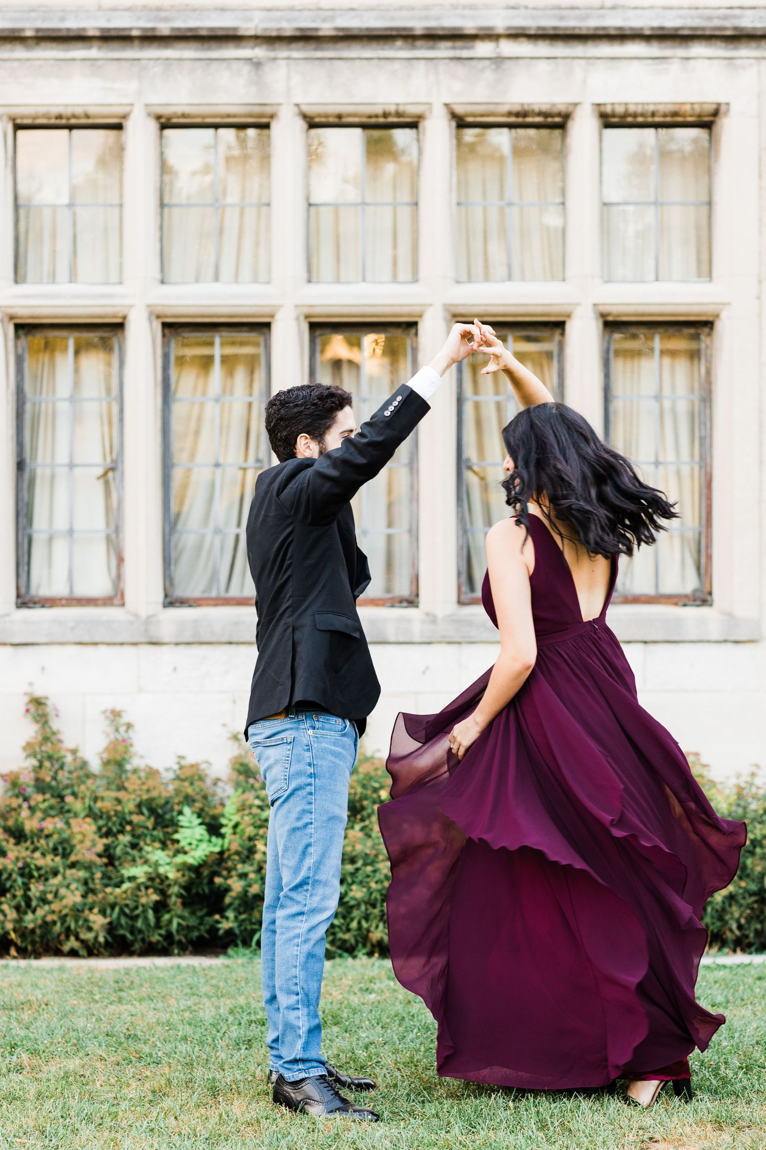 Couple twirling in front of Hartwood Acres Mansion