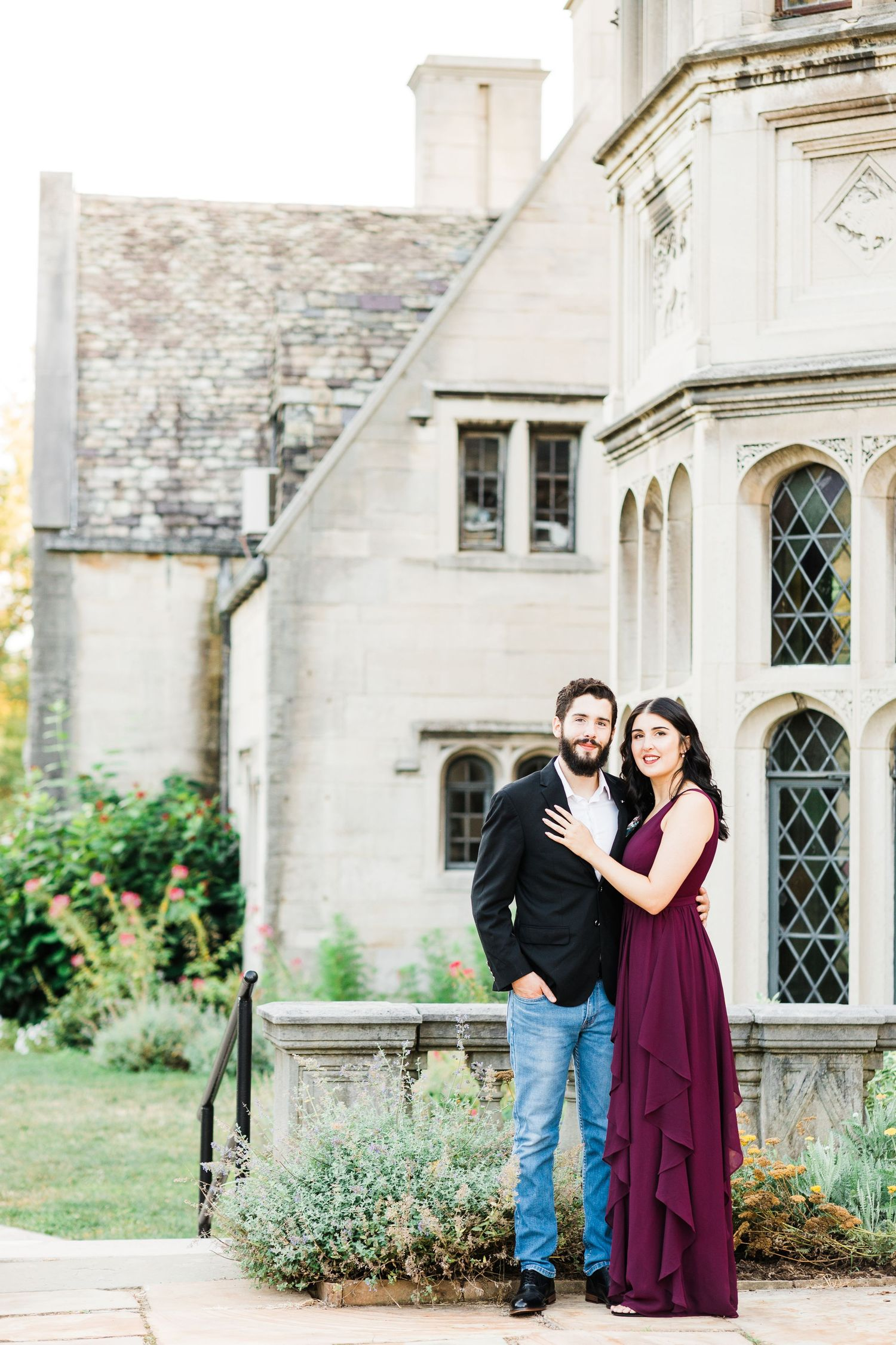 Couple standing in front of Hartwood Acres Mansion