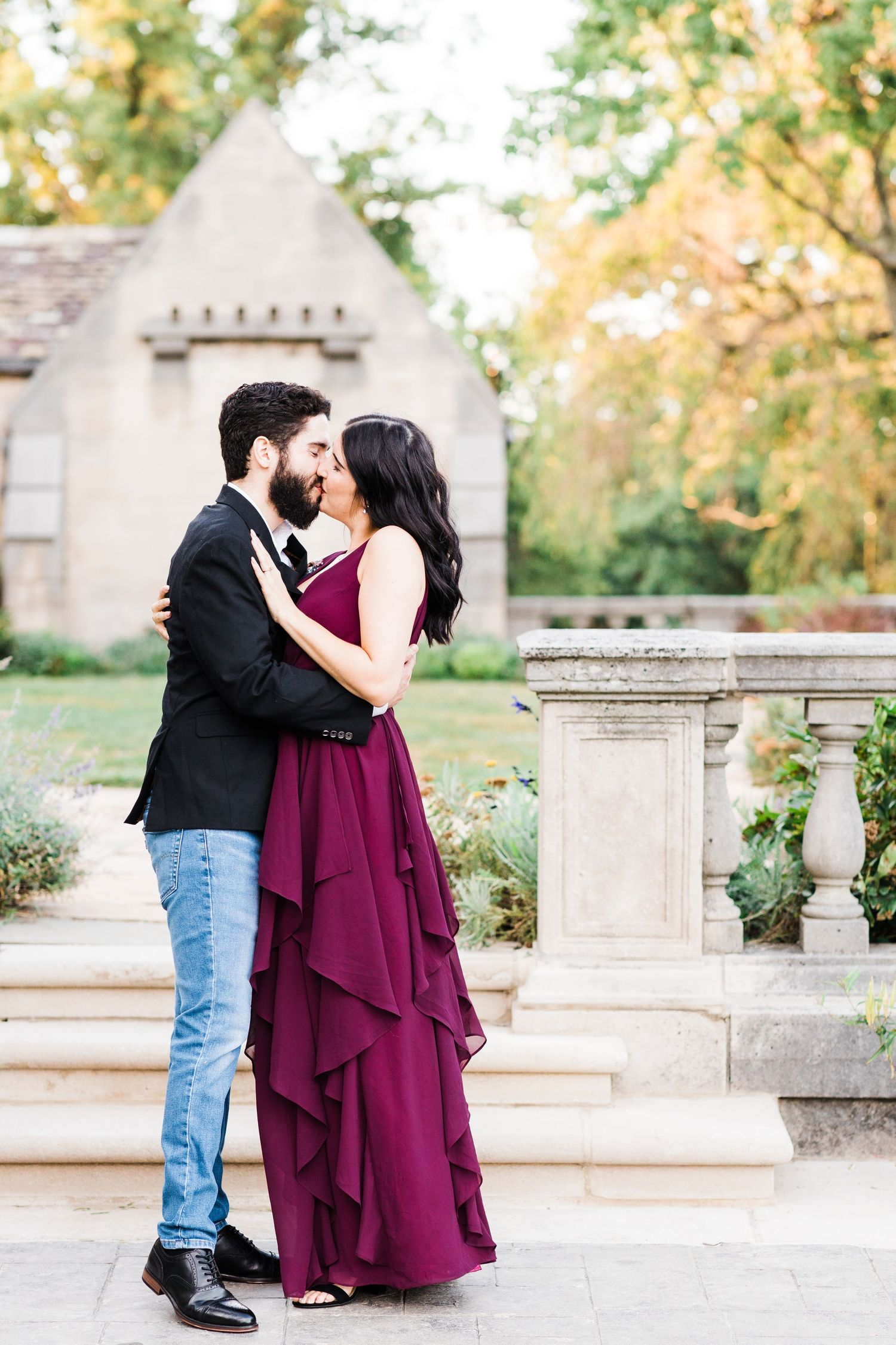 Couple kissing in front of Hartwood Acres Mansion