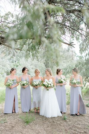 bridesmaids walking with flowers