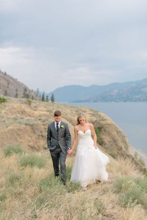 bride and groom walking at painted rock winery