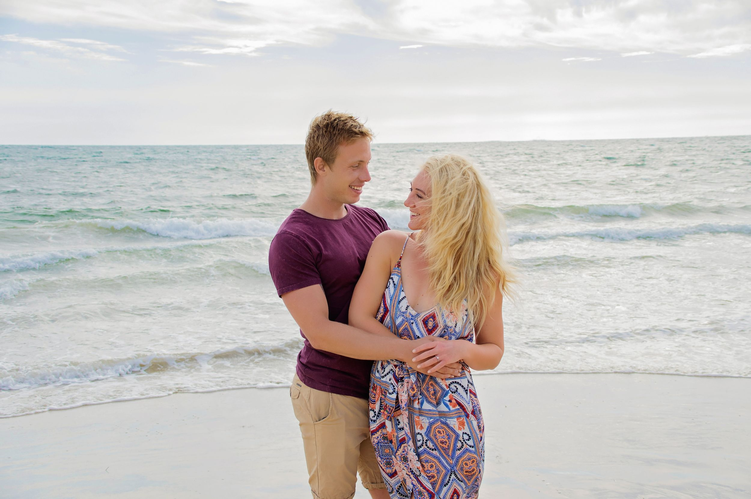 couple embracing on beach smiling