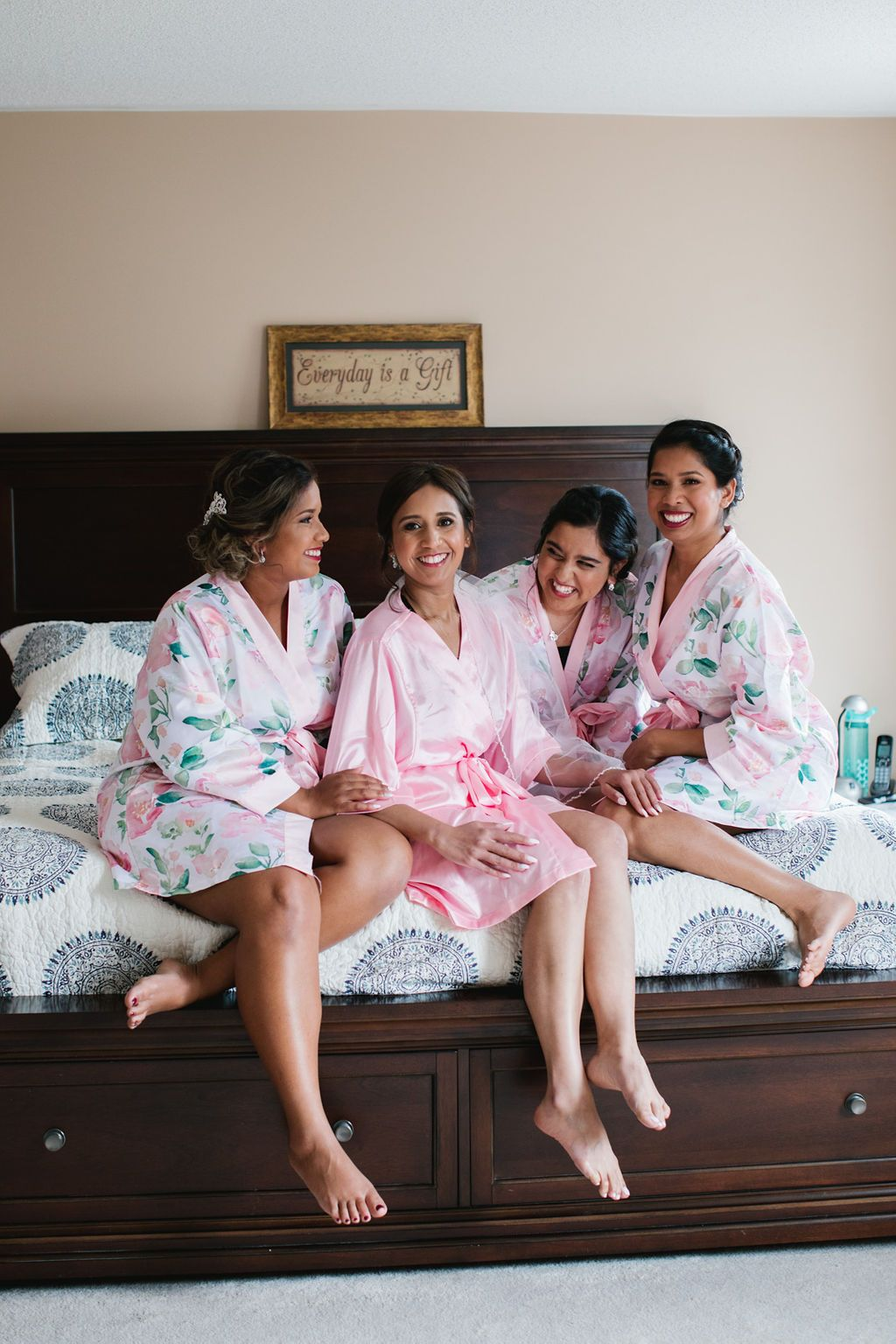 bridesmaids on bed laughing