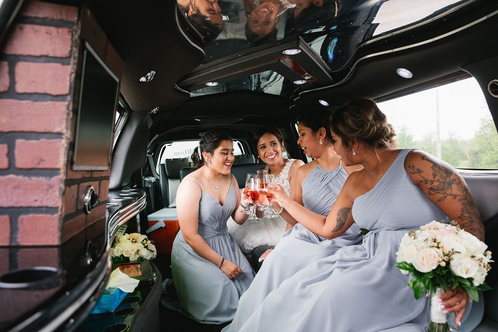 bride with bridesmaids in the limo