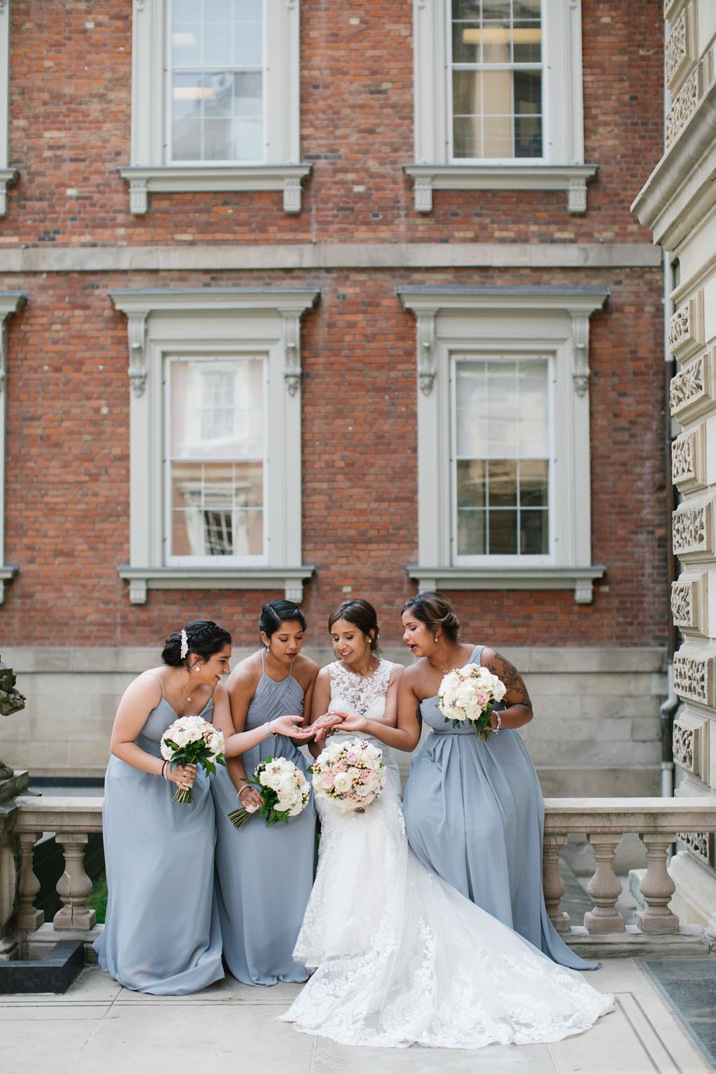 bridesmaids osgoode hall sitting and looking at ring