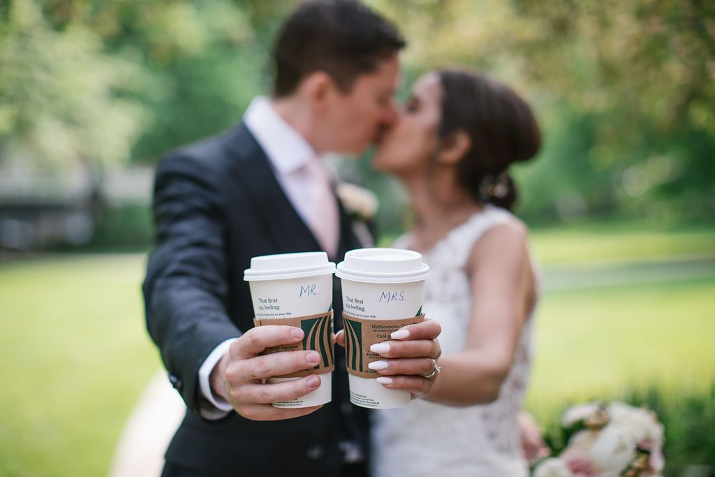 bride and groom holding starbucks coffee cups mr and mrs