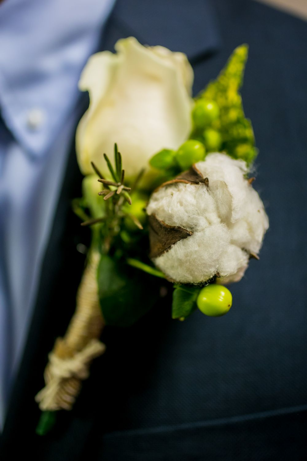 Groom Jason's boutonnière before his wedding at the South Carolina State Museum in Columbia, SC
