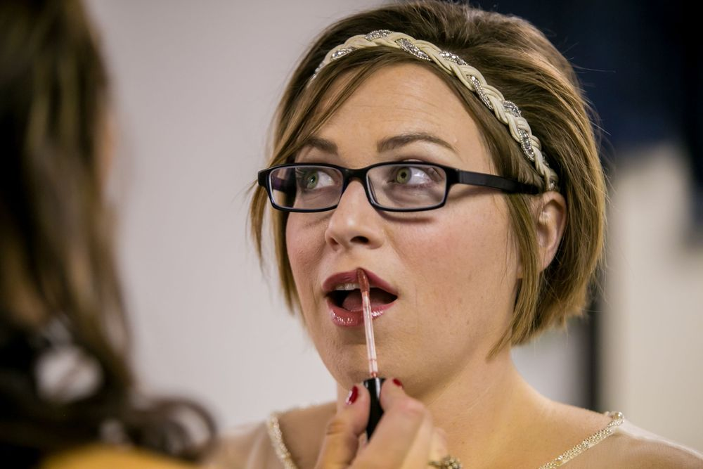 Bride Brooke has lipstick put on before her wedding at the South Carolina State Museum in Columbia, SC