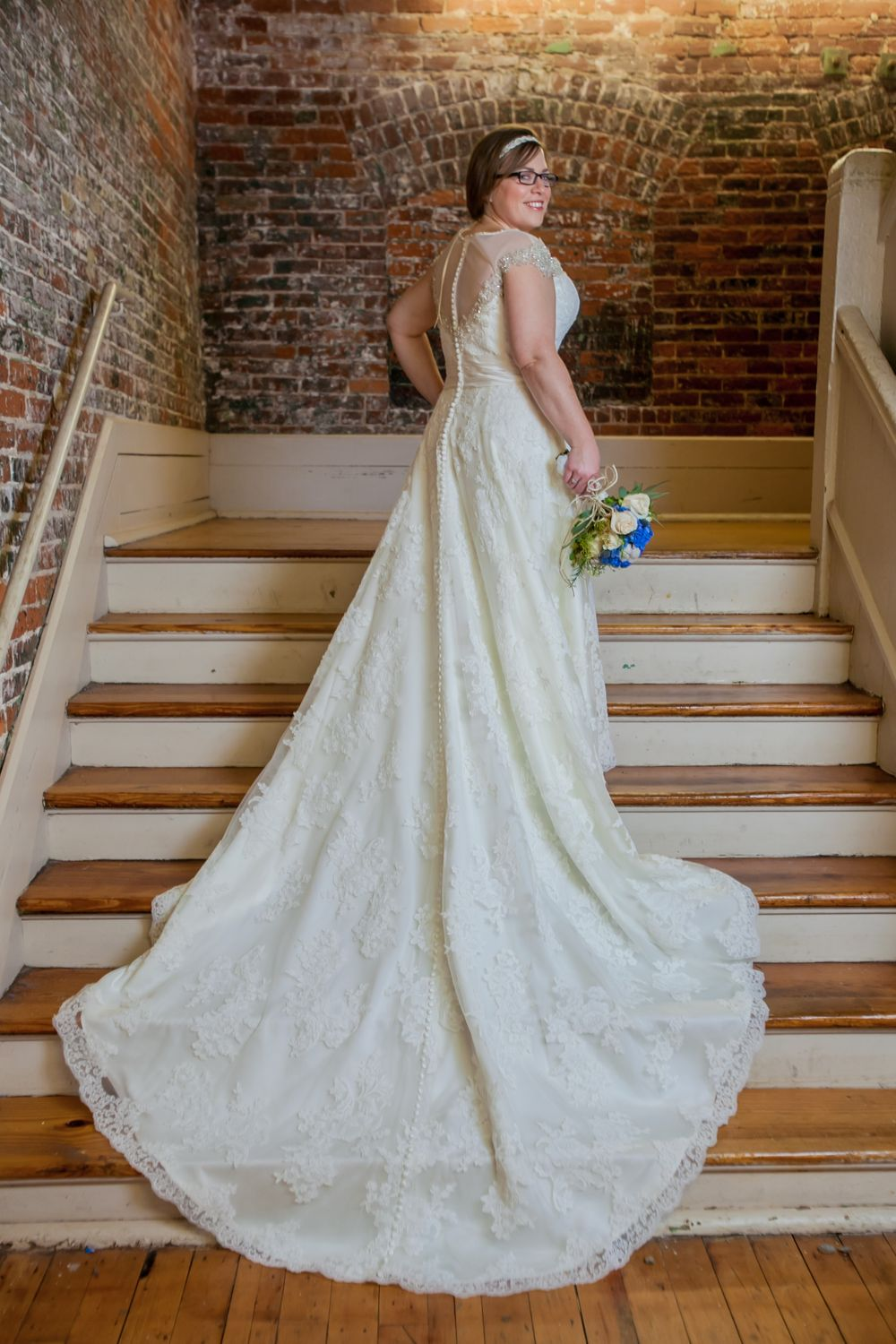 Brooke's bridal portrait on the steps before her wedding at the South Carolina State Museum in Columbia, SC