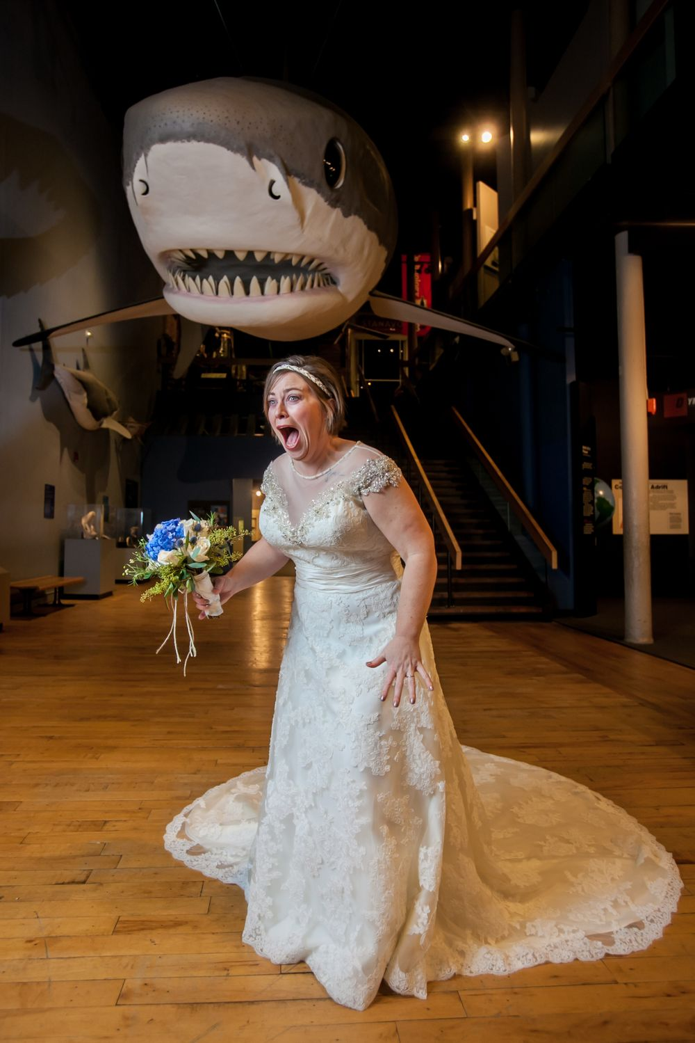 Bride Brooke poses in front of the shark before her wedding at the South Carolina State Museum in Columbia, SC