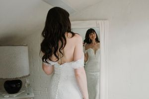 wedding preparation shot, bride getting ready, in mirror.