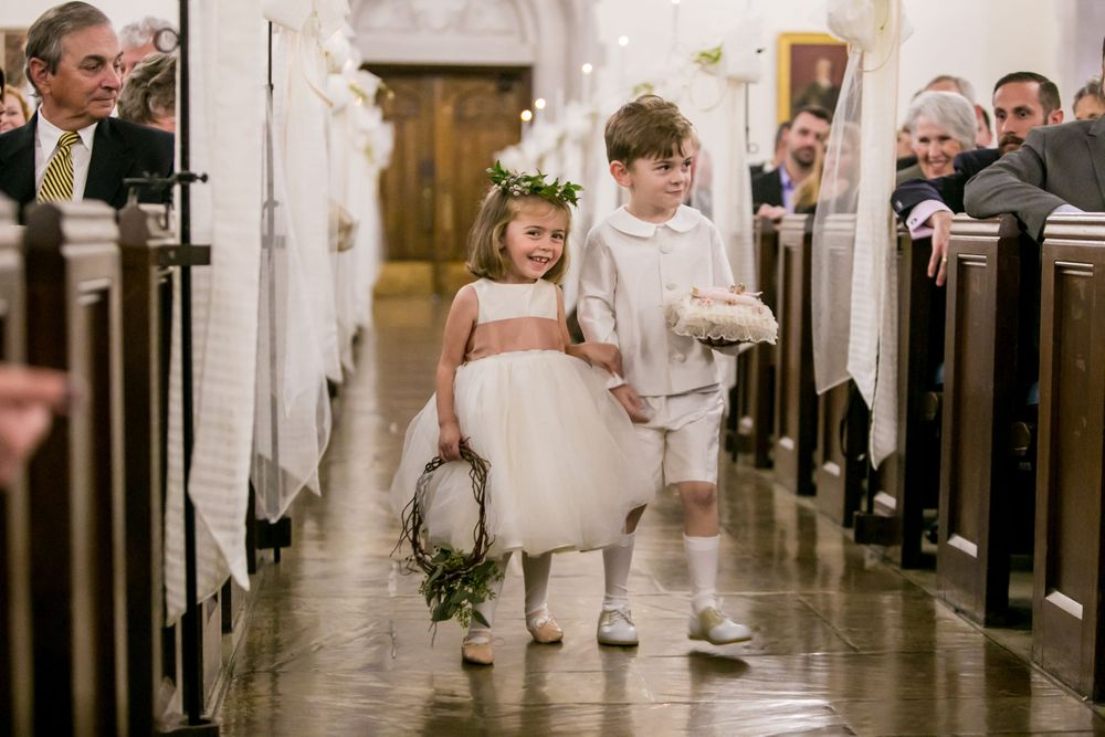 Flower Girl and Ring Bearer walk down the aisle during a wedding ceremony The Citadel's Summerall Chapel in Charleston