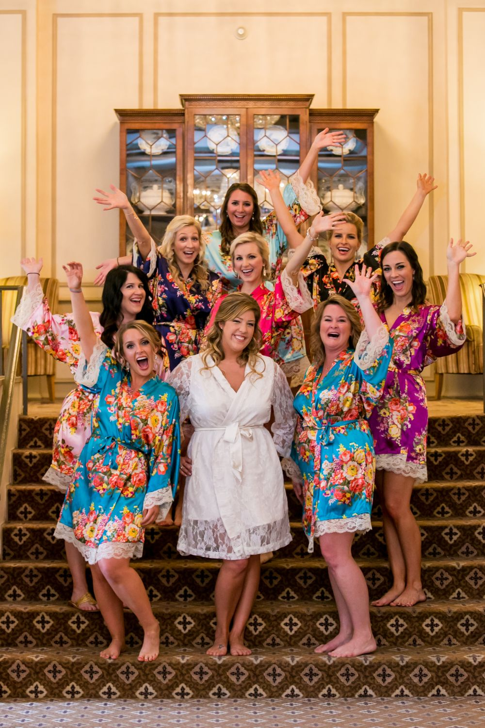 Alissa and her bridesmaids pose in robes while getting ready for the wedding at Francis Marion Hotel in Charleston, SC