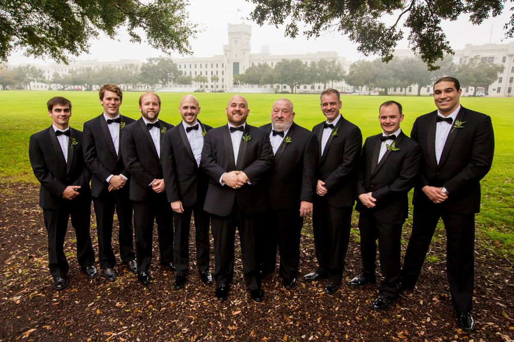 Charlie & his groomsmen pose in front of Summerall Chapel before his wedding there in Charleston, SC