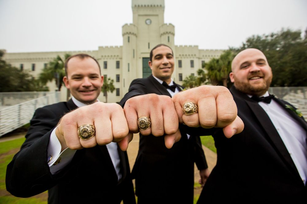 Charlie & his groomsmen pose w/ their Citadel class rings at Summerall Chapel before his wedding there in Charleston, SC