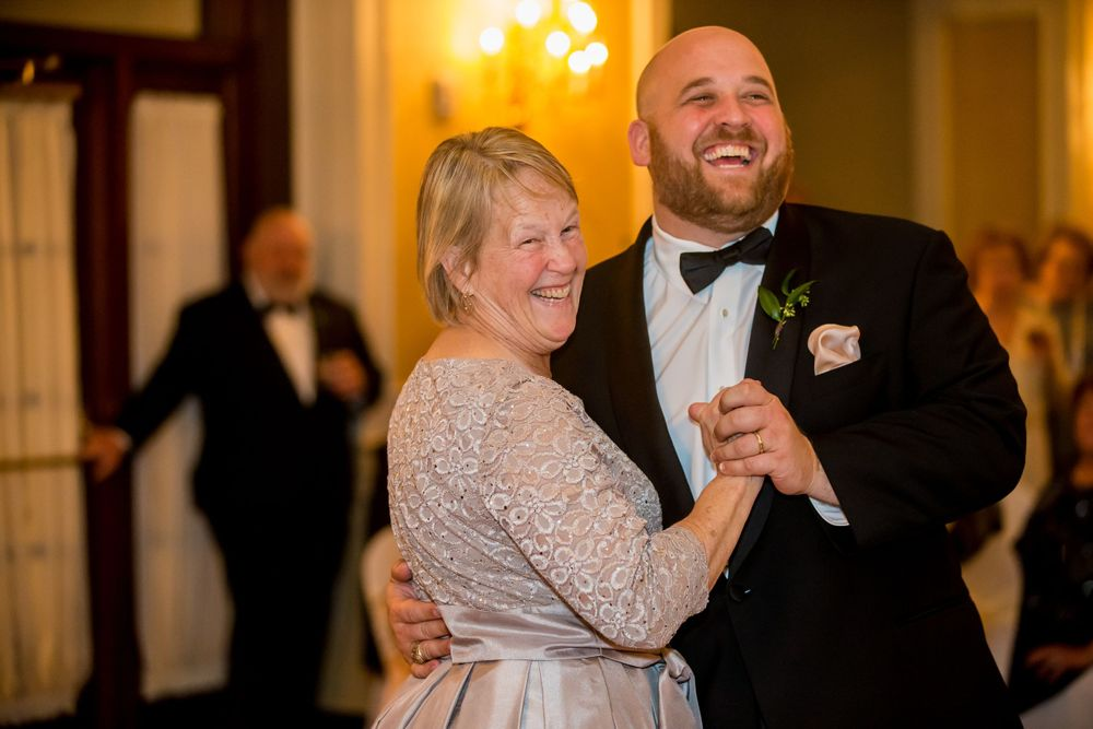 Groom Charlie dances with her mother during his wedding reception at Francis Marion Hotel in Charleston, SC