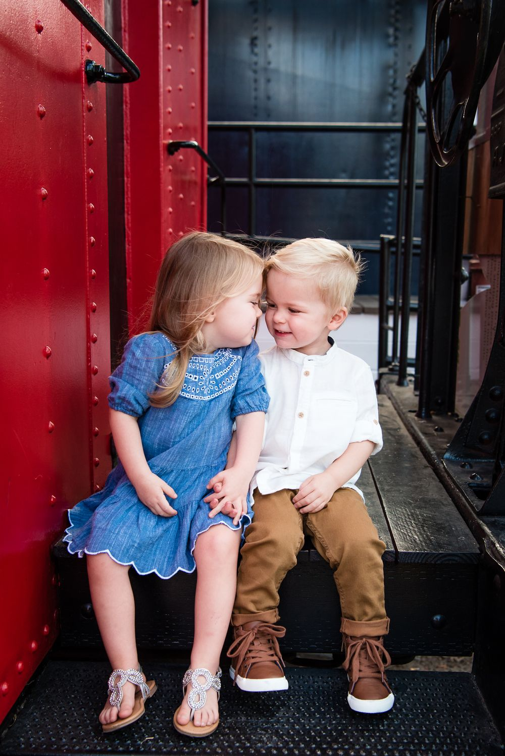 Image of a little brother and sister on a train car in San Juan Capistrano, CA