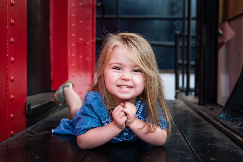 Image of a little girl on a train car in San Juan Capistrano, CA