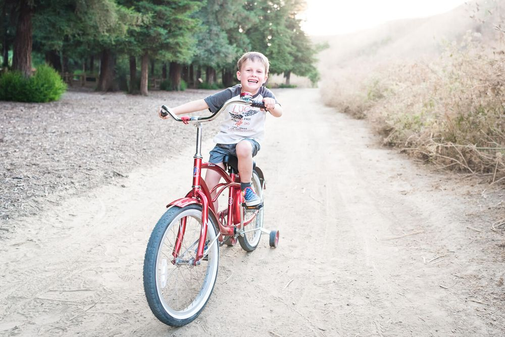 A photograph of a boy on a bike taken at Carbon Canyon Park in Brea, CA