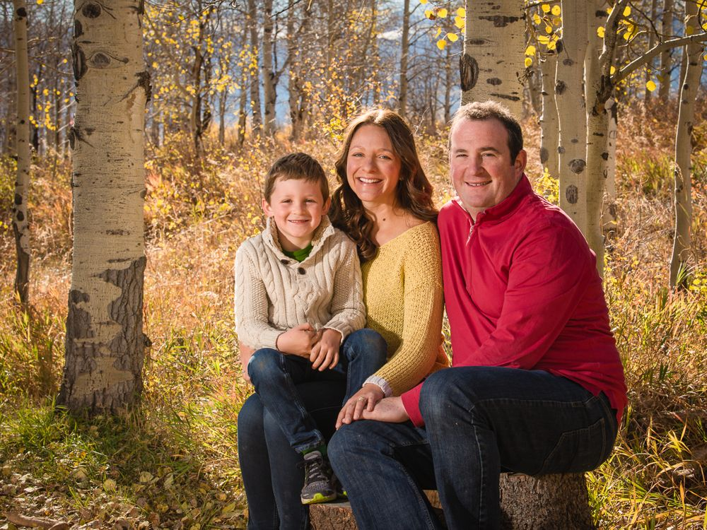 Golden fall family portrait (mom, dad and young son)