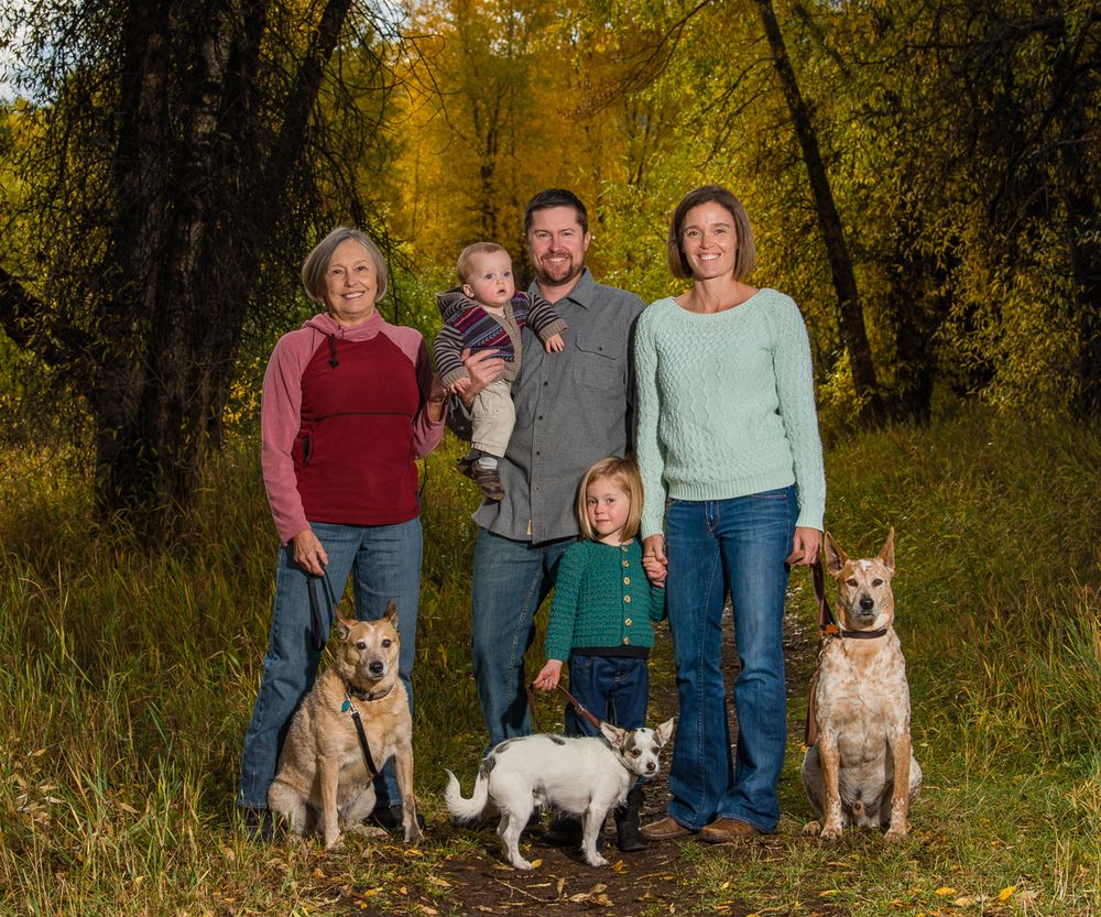 3 generation family with 3 dogs in the fall