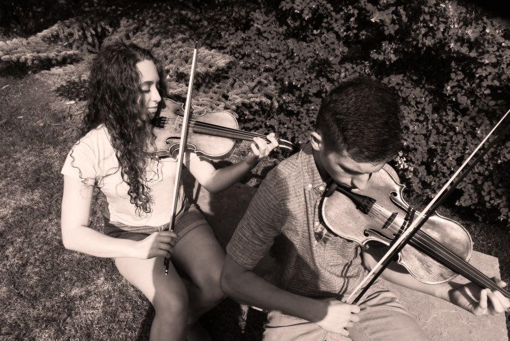 Brother and sister fiddling, sepia